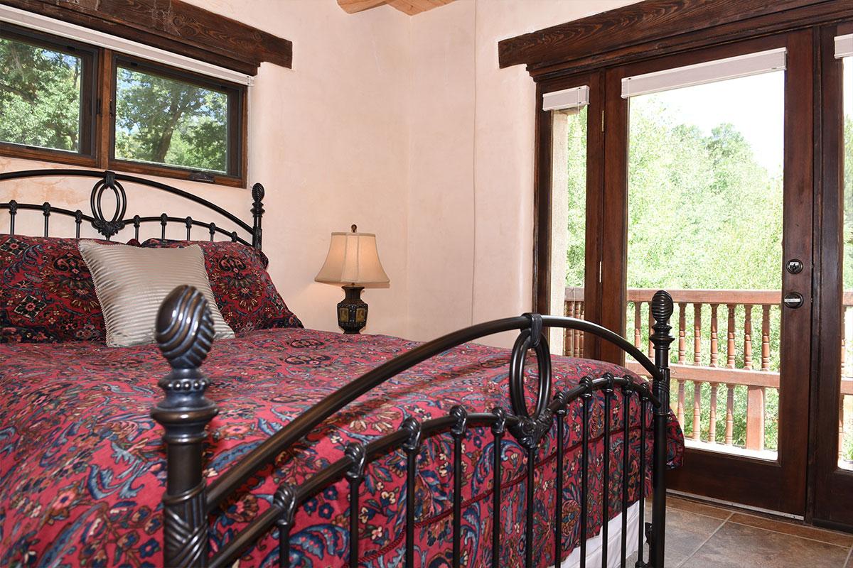Taos Villas-NM9-second-bedroom-showing-balcony